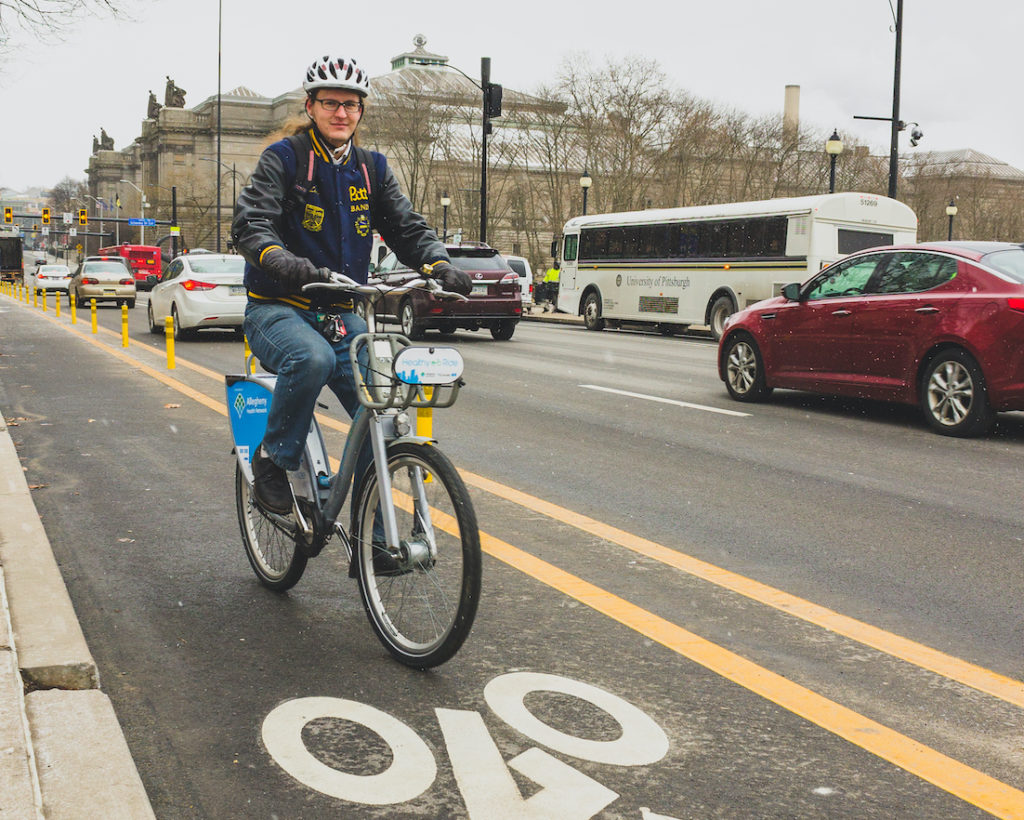 a person riding a Healthy Ride in a bike lane in Oakland in winter